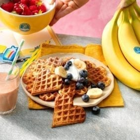 Chiquita banana waffles with blueberries and whipped cream