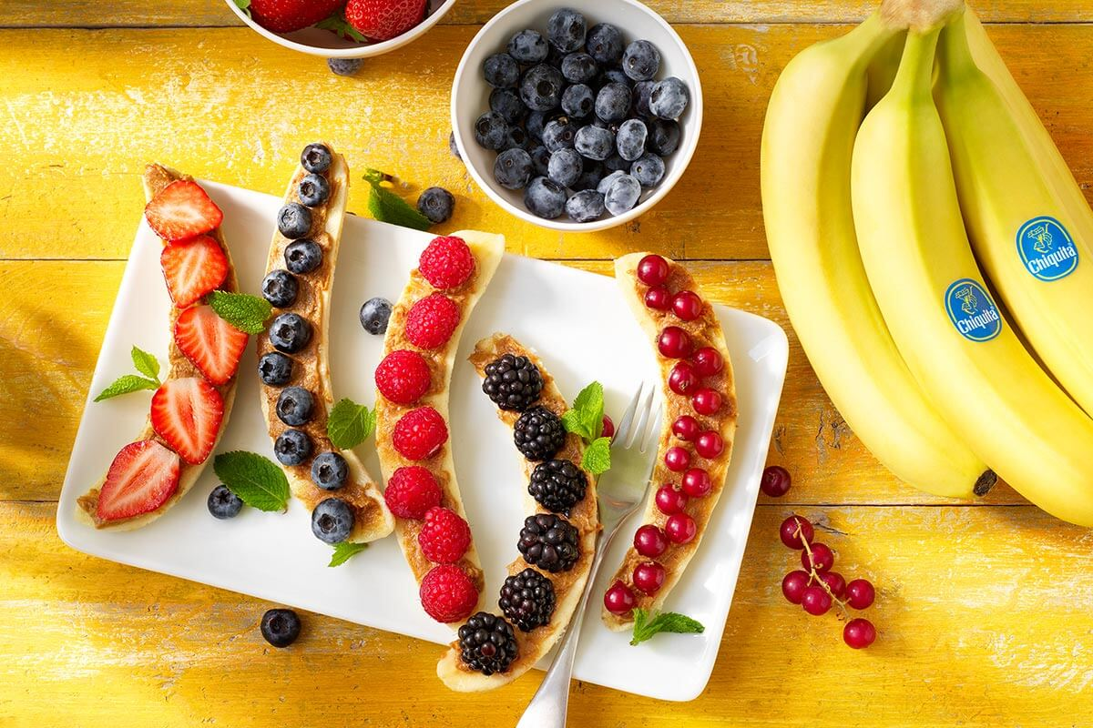 Chiquita banana split breakfast with red fruits and peanut butter