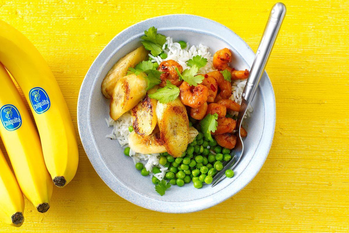 Fried marinated shrimp With peas, rice and fried banana