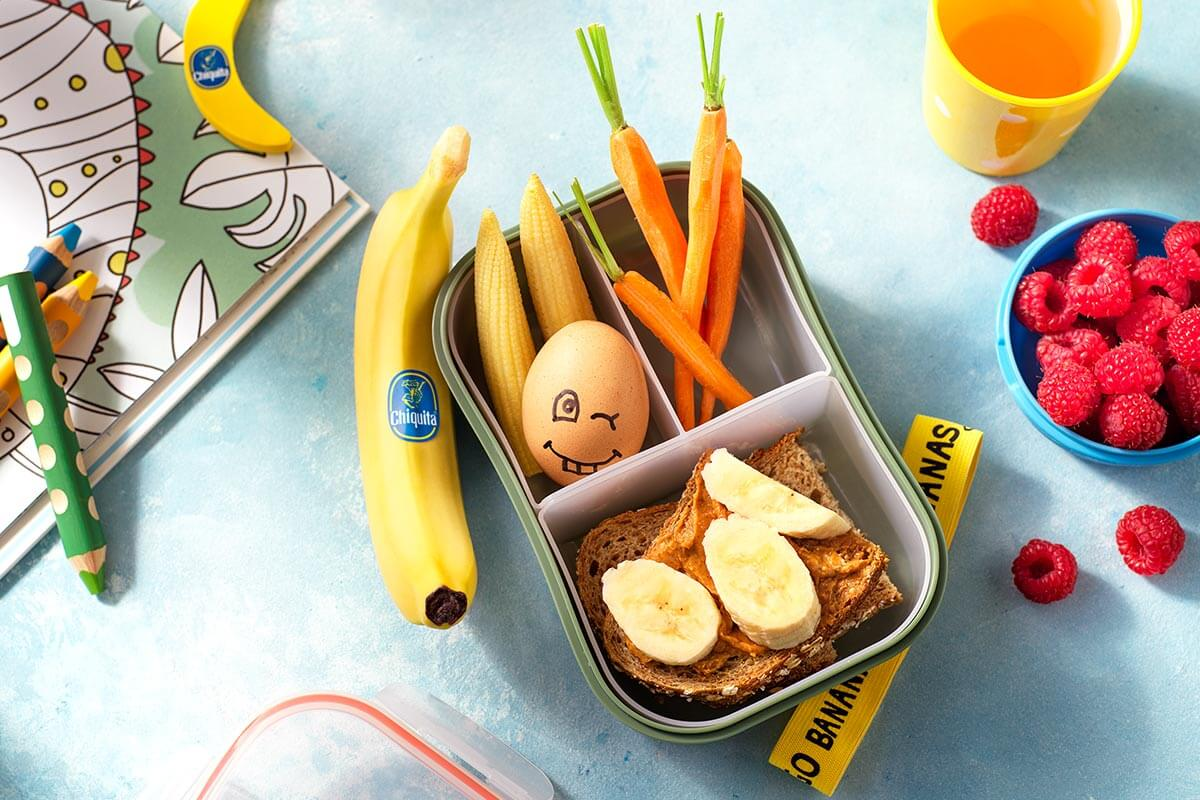 Snackbox with a peanut butter Chiquita banana sandwich, egg and fresh vegetables.